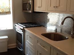 kitchen backsplash stainless steel tiles:  images about for the new home on pinterest pewter kitchen backsplash and mosaic backsplash