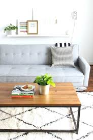 grey couch geometric rug wood coffee table black and white pillows runner