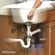 kitchen sink drain pipe smells bad my stinks why does