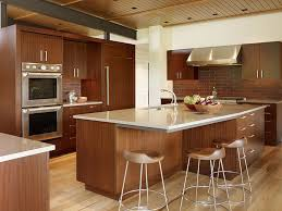 design your own kitchen using brown wooden kitchen cabinets and kitchen island with white granite countertop on light brown parquet in white wall