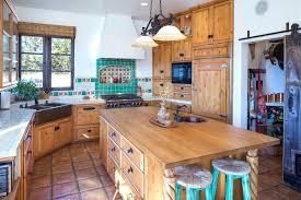 talavera tile kitchen ideas rustic with terracotta floors built in bookshelf and breakfast bar i g
