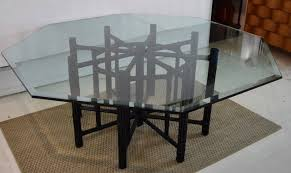 this is a mcguire bamboo table with eight bamboo legs and leather strapping the diameter