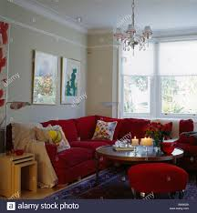 Townhouse Living Room Nest Of Tables Beside Red L Shaped Sofa In Small Townhouse Living