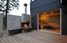 this concrete fireplace was cast into a custom built form and poured in one time the concrete seat was added after the fireplace cured and allows for close