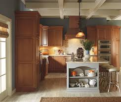 traditional kitchen design with cherry cabinets and a gray painted kitchen island