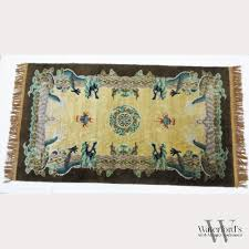 a chinese area rug with dragons and bats