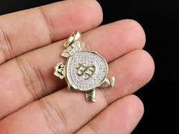 men s 10k yellow gold finish diamonds running money bag charm pendant 1 50 ct