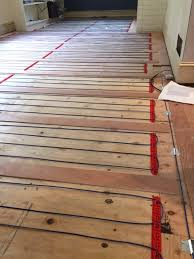 this image shows a loose cable system on a wood sub floor the installer