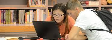 online application applysuny fulton montgomery 2 students using laptop