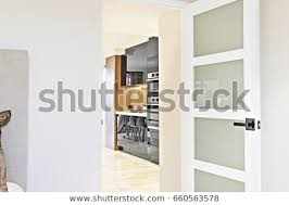 open door entrance to a kitchen of a room the door made in wood and