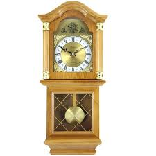oak pendulum wall clock the golden oak chiming pendulum wall clock is stained in a rich oak pendulum wall clock