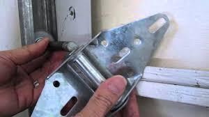 how to repair a broken garage door hinge or replace a roller