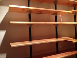 this diy shelf is built from reclaimed wood from an old bookshelf the levels are created using kee klamp fittings and pipe the pipe goes straight through