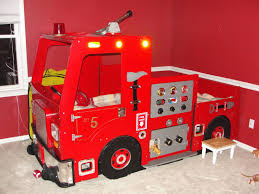red accent wall for kids bedroom decoration with glass window and fire truck bunk bed also