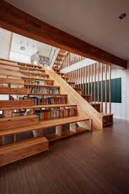 A Library Slide by Moon Hoon slides libraries books architecture - Stairs,  Library, Slide - Also the Wall facing the stairs has a big screen TV /  Projector ...