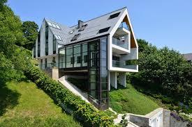 marvelous sloping house designs 1 glass elevator multiple levels slope house trendy sloping designs