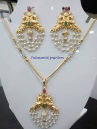 22 carat gold pea embellished light weight pearl pendant with studded rubies and emeralds all over simple gold fancy chain comes with the necklace