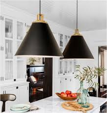 statement lighting. Large Black And Gold Pendant Lights Over White Marble Kitchen Island Statement Lighting G