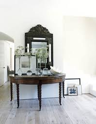 entryway table with mirror. Awesome Wall Mirror And Dry Floral Arrangement With Glass Vases Plus Small Entryway Table Tables Consoles Also Wood Flooring Interior C