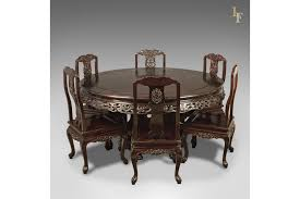 traditional oriental rosewood dining table and set of 6 chairs carved late c20th photo 1