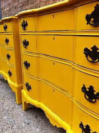 bright painted furniture. light distressing on just the edges this great yellow dresser from 23 expressive painted furniture ideas bright
