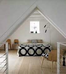 bedroom small attic bedroom sloping ceilings classic white ceiling fan light bird and poeple sculptures