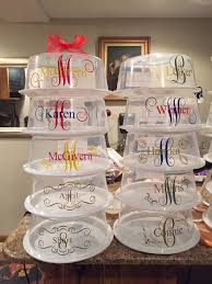 lots of Cake Carriers made with Cricut vinyl!