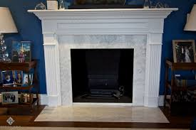 appealing white stone fireplace mantel with ornamental shelf and grey granite surround