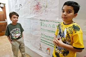 third graders william schutte left and seth garza stand beside an art project