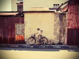 random wall art from http travel2penang wordpress 2012 06 29 penang street art wall cyclist art04 on famous wall art in penang with penang street art children on a bicycle art walls tiny spaces