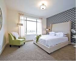 Example of a transitional carpeted bedroom design in Vancouver with  multicolored walls