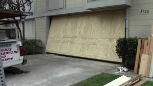 garage door opening on its ownA wood one piece garage door  YouTube