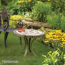 construct a small round patio table with a tiled plywood and cement board top and hand bent metal legs