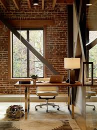 home office office wall. exposed brick wall backdrop is perfect for the industrial home office design palmer weiss e