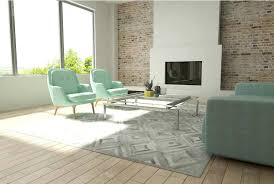 cowhide patchwork rug diamond gray cowhide patchwork rug in a sunny living room with aqua furniture