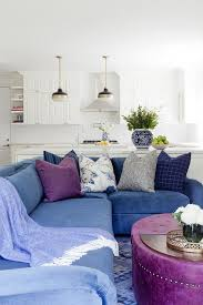 blue velvet sectional with purple oval ottoman coffee table