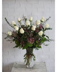 one dozen ultimate white roses