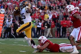 Iowa 56 Nebraska 14 Husked Black Heart Gold Pants