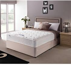 elegant bed linens with white queen memory foam mattress topper and upholstered  headboard on cozy berber