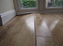 wood flooring expanded due to high moisture content in suloor