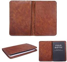the moleskine cahiers are journals with a flexible heavy duty cardboard cover in black with visible stitching on the spine the last 16 sheets are