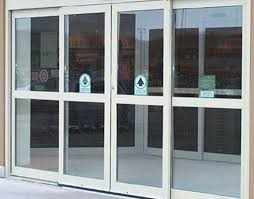 inspirative sliding front door with simple concept and clear glass for modern