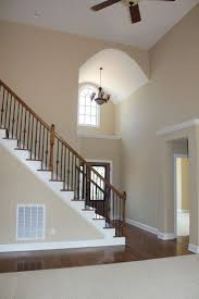 The decorative shelf above this front entrance has endless possibilities.  Like the wood and iron staircase