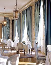Blue jacquard damask curtains add serious drama to the dining room of the  Cercle de l