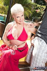 Over 70 granny Jewel exposing big tits outdoors and taking.
