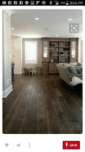 Wide Plank Hardwood Floors with White Baseboards and White Toe-Kick