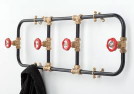 For a more playful and industrial look I love this Pipework Coat Rack 125  from Clippings.