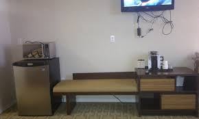 furniture choice. super 8 peace river ab: tv cords hanging, curious furniture choice