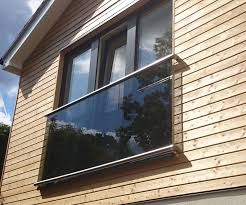 wall d juliette balcony with stainless steel slotted channel top and bottom and tinted glass