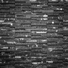 old black brick wall pattern as background stock photo